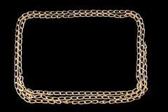 Pozłocisty łańcuszek na czarnym tle Fotografia Stock