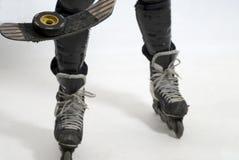 poziomy hokejowy puck łyżew patyk fotografia stock