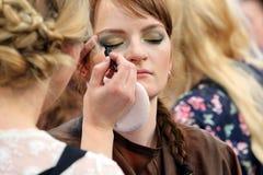 POZNAN - APRIL 18: Young girl during makeup process at The Look Royalty Free Stock Photo
