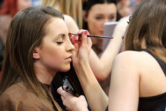 POZNAN - APRIL 18: Young girl during makeup process at The Look Stock Photos