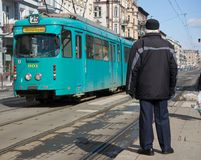 Man waiting for tram Stock Image