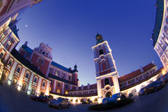 Poznan Old Town. Collegiate Church of Our Lady of Perpetual Help and St.. Mary Magdalene and city council in Poznan, Poland Evening on April 10 royalty free stock image