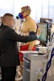 POZNAN, POLAND - APRIL 12. 2016: Doctor performing an EKG test o Royalty Free Stock Photo