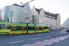 Poznan, Poland - December 05, 2018: The building of the Academy of Music in Poznan. Poland. Poznan, Poland - December 05, 2018: The modern tram Solaris Tramino royalty free stock photo
