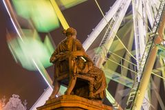 POZNAN, POLAND - DECEMBER 16, 2017. Hygieia fountain monument at the Freedom Square Plac Wolnosci with a ferris wheel background Royalty Free Stock Photography