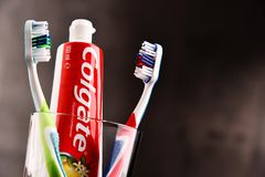Composition with Colgate toothpaste and toothbrush. POZNAN, POLAND - FEB 14, 2018: Colgate toothpaste, a brand of oral hygiene products manufactured by American stock photo