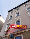 Roti 24h Bistro. Poznan, Poland - February 20, 2018: Roti 24h Bistro sign on a apartment building in the city center royalty free stock photography
