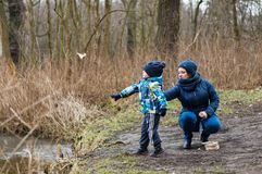 Woman and boy by a pond Royalty Free Stock Images