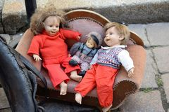 Poznan-Poland. Flea market in Old Market Square. Poznan-Poland. Second-hand old dolls on a small sofa for sale Royalty Free Stock Photography