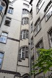 Poznan-Poland. An interesting tiled building. Poznan-Poland. A charming building covered in polished tiles with interesting windows - view from the backyard Royalty Free Stock Images