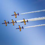 POZNAN, POLAND - JUNE 14: Aerobatic group formation. Baltic Bees at blue sky during Aerofestival 2015 event on June 14, 2015 in Poznan, Poland Royalty Free Stock Image