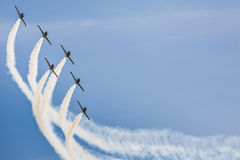 POZNAN, POLAND - JUNE 14: Aerobatic group formation. Baltic Bees at blue sky during Aerofestival 2015 event on June 14, 2015 in Poznan, Poland Stock Photography
