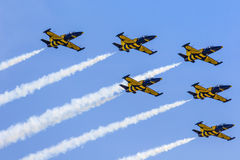 POZNAN, POLAND - JUNE 14: Aerobatic group formation. Baltic Bees at blue sky during Aerofestival 2015 event on June 14, 2015 in Poznan, Poland Royalty Free Stock Photography