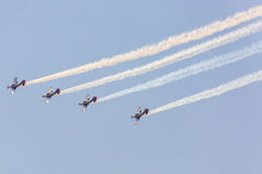 POZNAN, POLAND - JUNE 14: Aerobatic group formation. Pioneer Team at blue sky during Aerofestival 2015 event on June 14, 2015 in Poznan, Poland Royalty Free Stock Photo