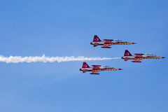 POZNAN, POLAND - JUNE 14: Aerobatic group formation. Turkish Stars at blue sky during Aerofestival 2015 event on June 14, 2015 in Poznan, Poland Royalty Free Stock Photo