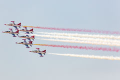 POZNAN, POLAND - JUNE 14: Aerobatic group formation. Turkish Stars at blue sky during Aerofestival 2015 event on June 14, 2015 in Poznan, Poland Stock Image
