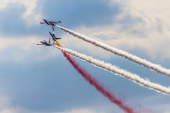 POZNAN, POLAND - JUNE 14: Aerobatic group formation. Turkish Stars at blue sky during Aerofestival 2015 event on June 14, 2015 in Poznan, Poland Royalty Free Stock Image