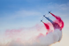 POZNAN, POLAND - JUNE 14: Aerobatic group formation. Turkish Stars at blue sky during Aerofestival 2015 event on June 14, 2015 in Poznan, Poland Royalty Free Stock Images