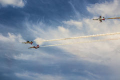 POZNAN, POLAND - JUNE 14: Aerobatic group formation. Turkish Stars at blue sky during Aerofestival 2015 event on June 14, 2015 in Poznan, Poland Royalty Free Stock Photography