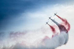 POZNAN, POLAND - JUNE 14: Aerobatic group formation. Turkish Stars at blue sky during Aerofestival 2015 event on June 14, 2015 in Poznan, Poland Royalty Free Stock Photos