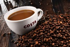 Cup of Costa Coffee coffee and beans Royalty Free Stock Photos