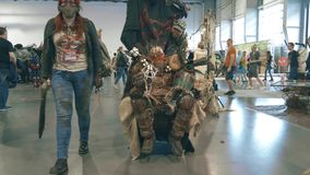 POZNAN, POLAND - MAY 19, 2018. Pyrkon convention participants wearing apocalyptic military costumes. POZNAN, POLAND - MAY 19 2018 Pyrkon convention participants stock image