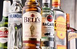 Bottles of assorted global hard liquor brands Stock Image