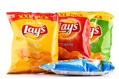 Packets of Lays potato chips isolated on white. POZNAN, POLAND - OCT 25, 2017: Packets of Lay's potato chips, popular American brand founded in 1932 and owned by Stock Images