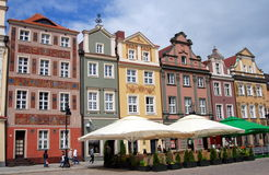 Poznan, Poland: Rynek Old Market Square. A row of handsome, colourful, restored 17th century baroque houses line the historic Rynek Old Market Square in Poznan Royalty Free Stock Photography