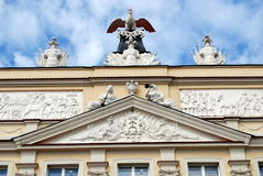 Poznan, Poland: Rynek Square Mansion. Baroque 17th century mansion with sculptures from the Dzialynski Palace with its notable rooftop pelican in the Rynek Old Royalty Free Stock Photography
