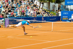 Poznan Porshe Open 2009 - Y.Schukin (KAZ) play. Yuri Schukin (KAZ) plays during final match at Poznan Porsche Open 2009. Finals of International ATP Tennis Stock Image