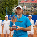 Poznan Porshe Open 2009 - Y.Schukin with trophy. Yuri Schukin (KAZ) receives second place during final match with Peter Luczak (AUS) at Poznan Porsche Open 2009 Stock Photos