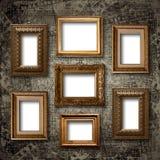 Pozłociste drewniane ramy dla obrazków na kamiennej ścianie Obrazy Royalty Free