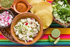 Pozole Mexican corn soup, Traditional food in Mexico made with corn grains. Tostadas royalty free stock photo