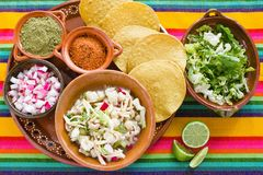 Pozole Mexican corn soup, Traditional food in Mexico made with corn grains. Tostadas royalty free stock image