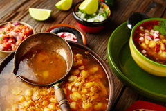 Pozole with mote big corn stew from Mexico in  cooking pot. Pozole with mote big corn stew from Mexico in old cooking pot Royalty Free Stock Photography