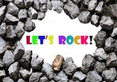 Pozwala my rockowi napisał na kamiennej ścianie Fotografia Royalty Free