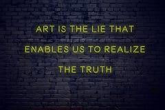 Pozytywna inspiruje wycena na neonowym znaku przeciw ściany z cegieł sztuce jest kłamstwem który umożliwia my uświadamiać sobie p zdjęcia stock