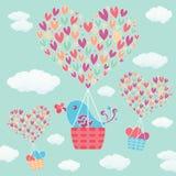 Pozytywna ręka rysująca wektorowa tekst miłość jest w powietrze dekorującej gorące powietrze balonu komarnicie z chmurami, niebem Obrazy Stock