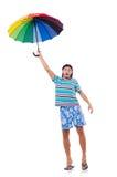 Pozytywny mężczyzna z kolorowym parasolem odizolowywającym dalej Zdjęcia Royalty Free