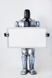 Pozytywny nowożytny robot trzyma białego signboard Obraz Stock