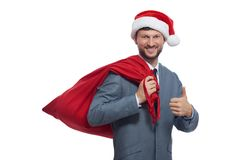 Pozytywny Santa Claus pokazywać super palcowym i uśmiechniętym Fotografia Stock