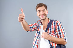 Pozytywny uczeń thumbing up Zdjęcia Royalty Free