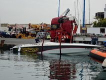 Baia - Motorboat to be lifted. Pozzuoli, Naples, Campania, Italy - April 11, 2018: Phase of lifting a motorboat in the port of Baia to load it on the truck royalty free stock photos