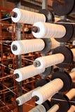 PP tape bobbins. A few polypropylene bobbins on creel Royalty Free Stock Image