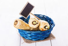 Pparsnips in a blue woven basket Stock Images