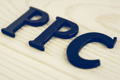 PPC (or Pay Per Click) sign on wood background - vintage tone Royalty Free Stock Photo