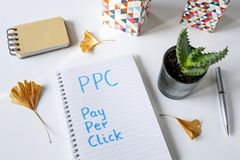 PPC Pay Per Click written in notebook royalty free stock photo