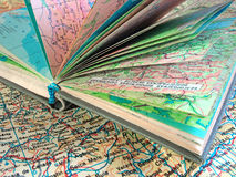 Ppened old atlas book on the spread map Stock Photos