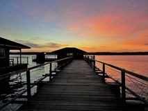 Sunset over PPK Merbok Floating Chalets in Kedah, Malaysia. PPK Merbok Floating Chalets in Kedah, Malaysia is located in the vicinity of Segantang Garam Village stock photo